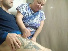 the saleswoman helps to masturbate in the fitting room